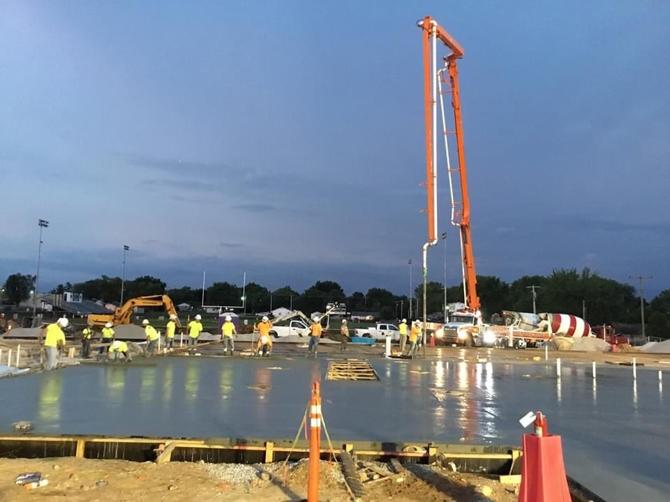 Construction crew pouring DCTC foundation floor photo