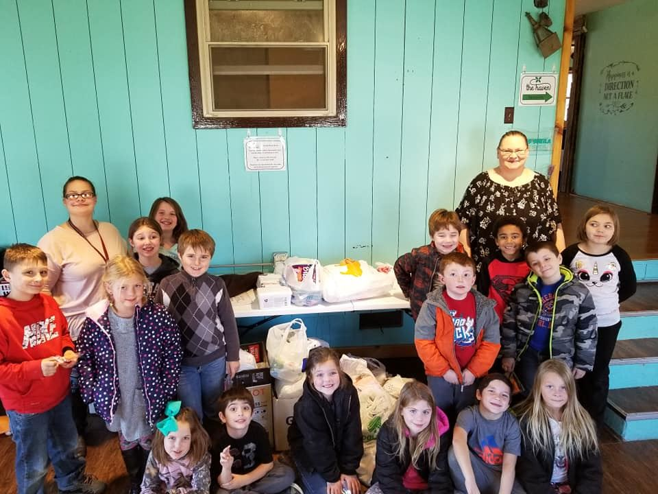 Photo of Mrs. Mekis's second grade class with Ms. Hulsey at The Haven.