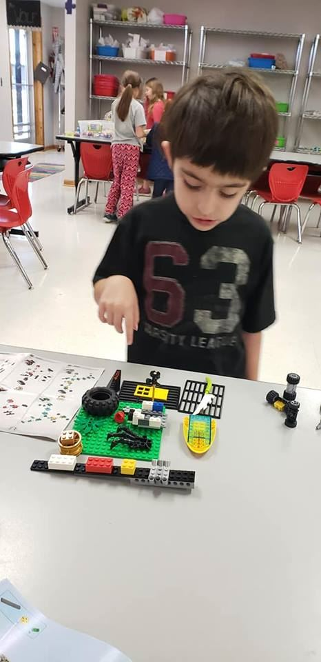 Student and legos photo