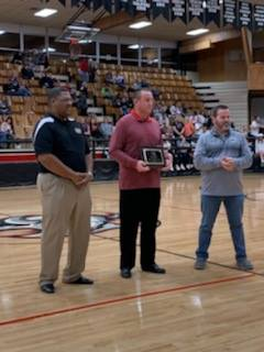 Coach Phillips receiving sportsmanship award photo